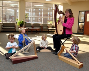 Harps with children image